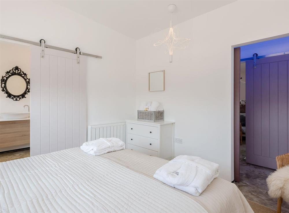 Comfortable double bedroom at Seaglass Barn (Sand),