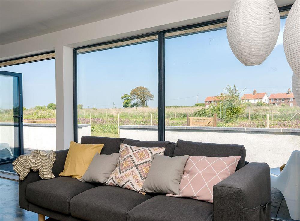 Comfy living area at Seaglass Barn (Sand),