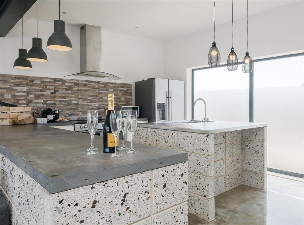 Large well appointed kitchen with an island at Seaglass Barn (Sand),