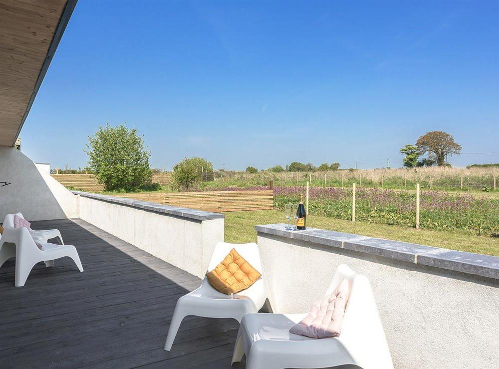 Relaxing decking area (photo 3) at Seaglass Barn (Sand),