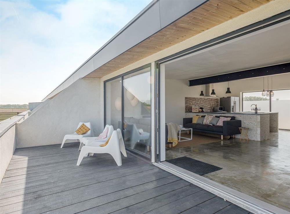 Relaxing decking area at Seaglass Barn (Sand),
