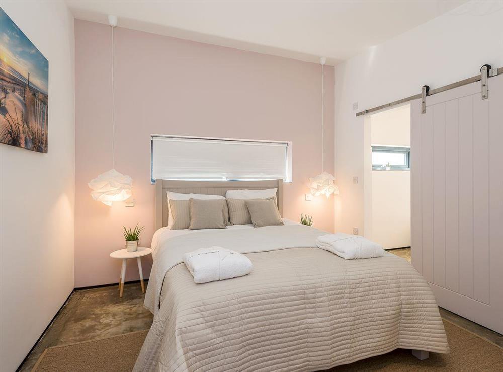 Stylish double bedroom at Seaglass Barn (Sand),