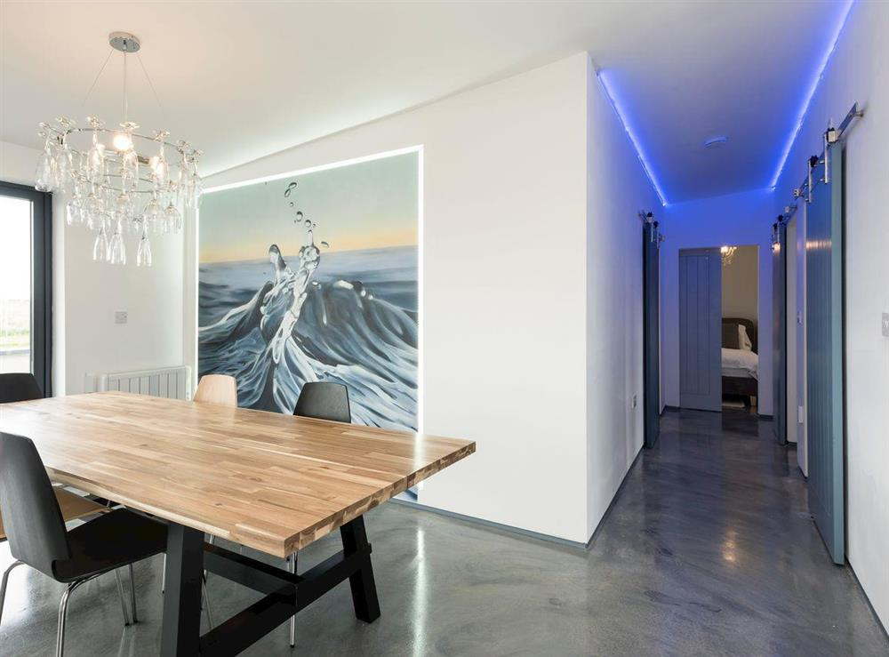 Dining area with hallway to bedrooms and bathroom at Seaglass Barn (Sea),