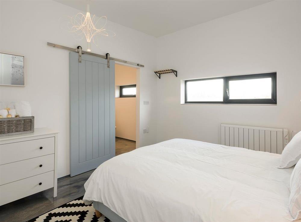 Master bedroom with en-suite at Seaglass Barn (Sea),