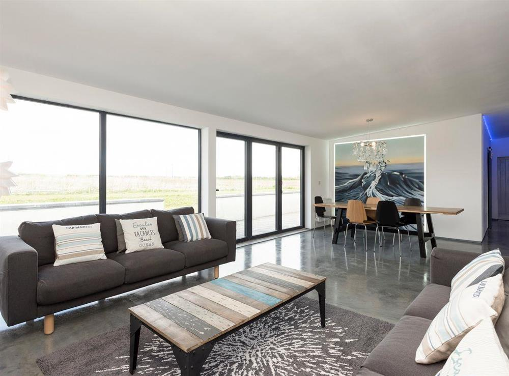 Modern living space with convenient dining area at Seaglass Barn (Sea),