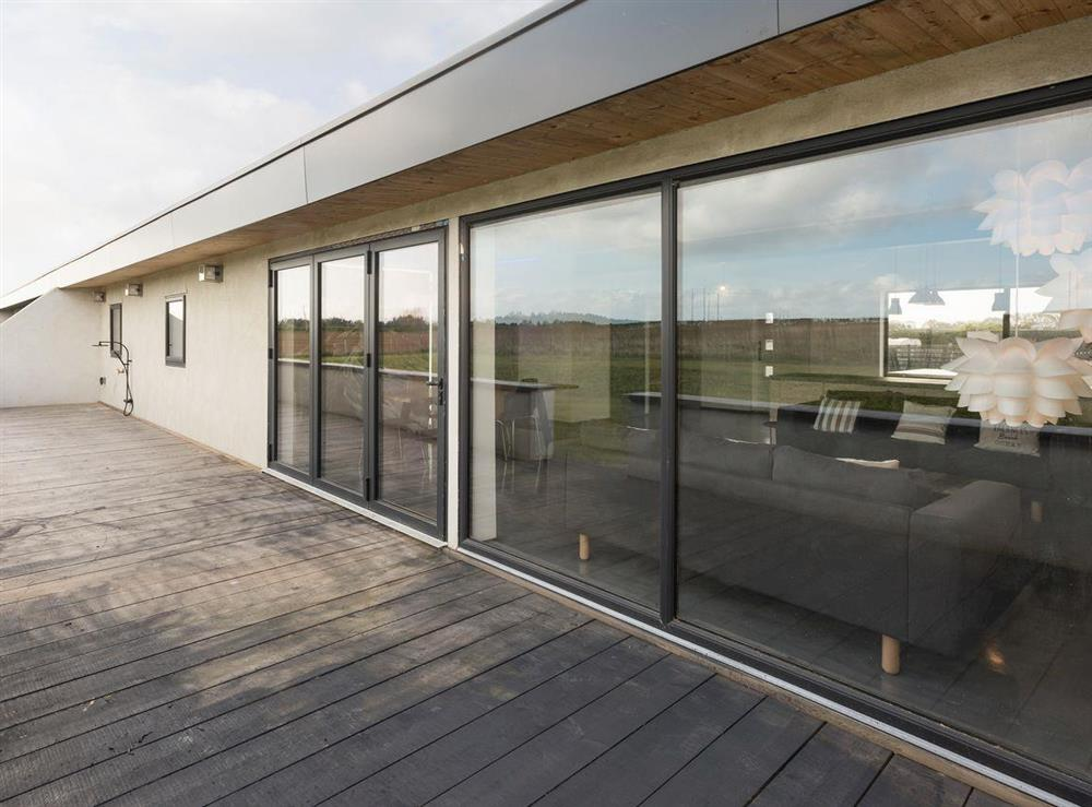 Spacious decked area at front of property at Seaglass Barn (Sea),