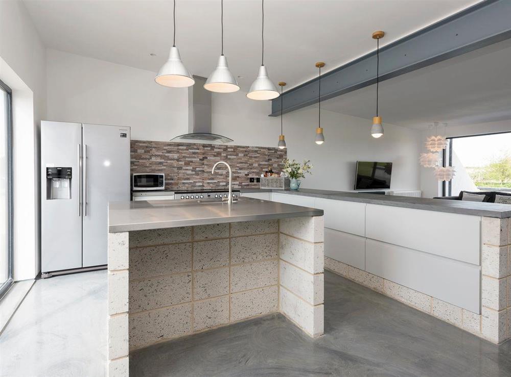Stylish kitchen and kitchen 'island' at Seaglass Barn (Sea),