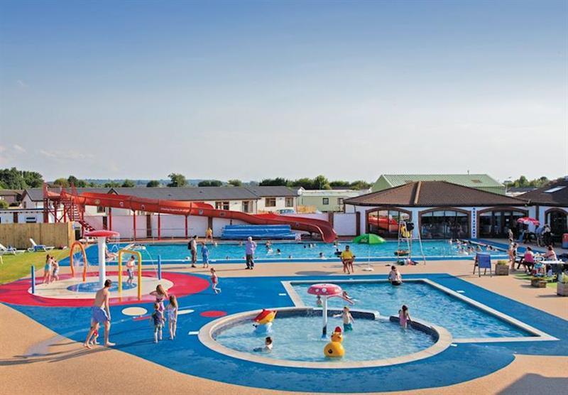 Outdoor heated swimming pool at Searles Leisure Resort in , Hunstanton