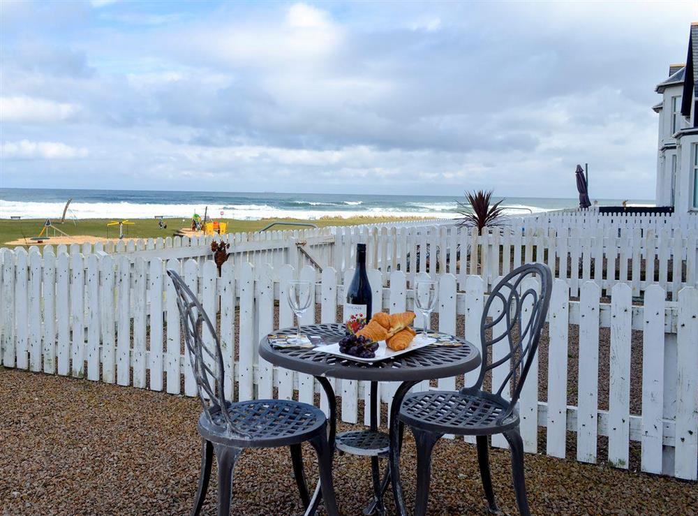 Enclosed, gravelled front patio with garden furniture and fantastic sea views at Seascape in Inverboyndie, near Banff, Aberdeenshire