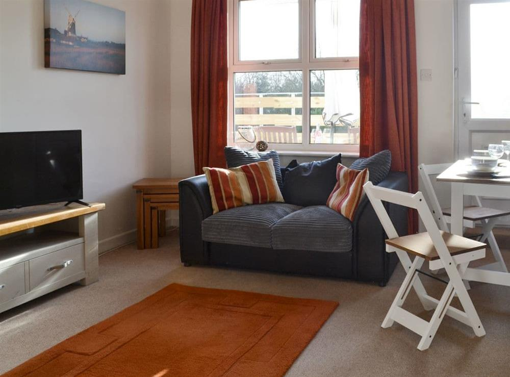 Welcoming living and dining room at Seashell Heights in Mundesley, near North Walsham, Norfolk