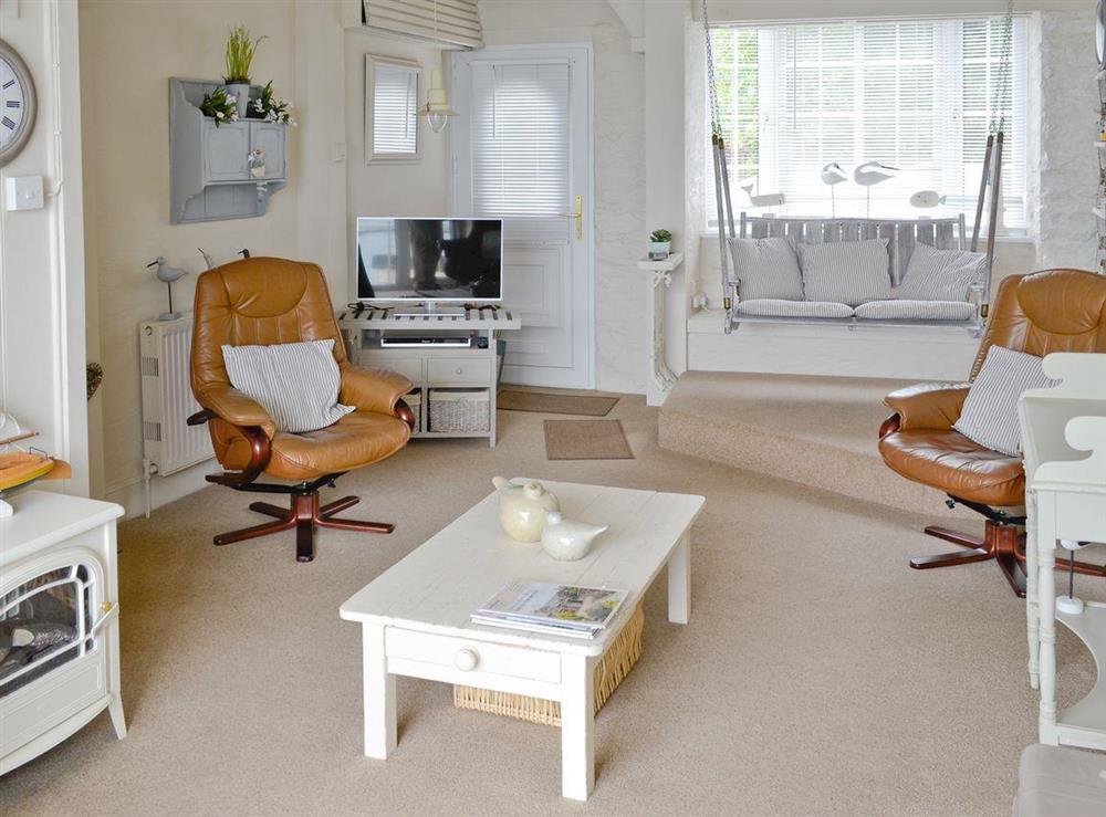 Stylish living room at Seaside Stories in Brixham, Devon