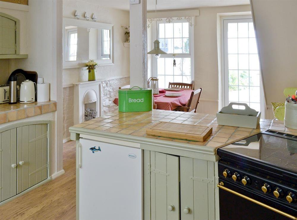 Well-equipped kitchen adjoins dining room at Seaside Stories in Brixham, Devon