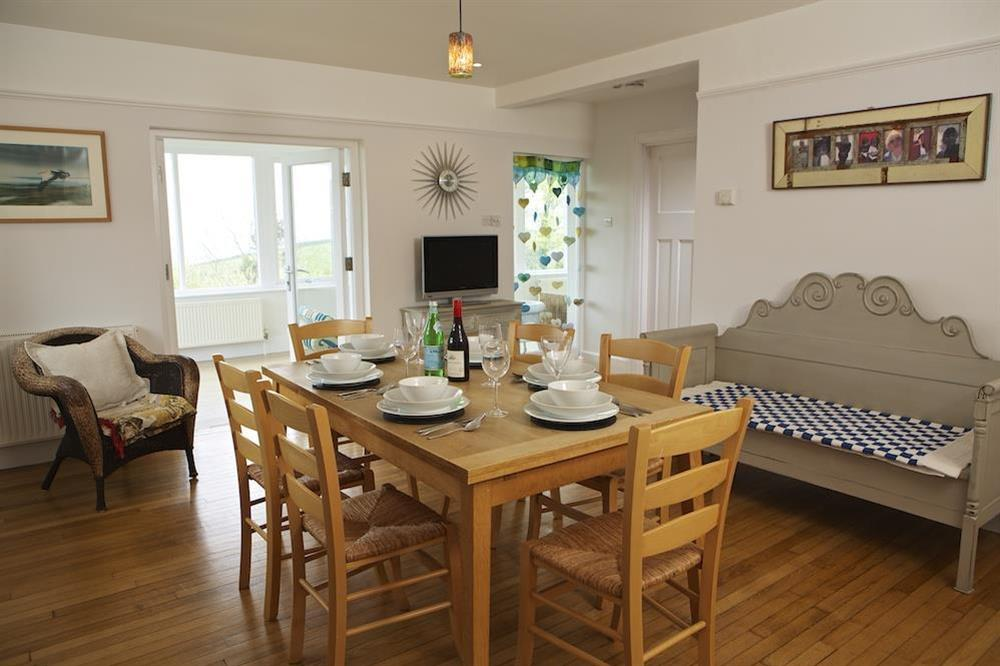 Dining area leading to the sun room at Seaway House in , Strete