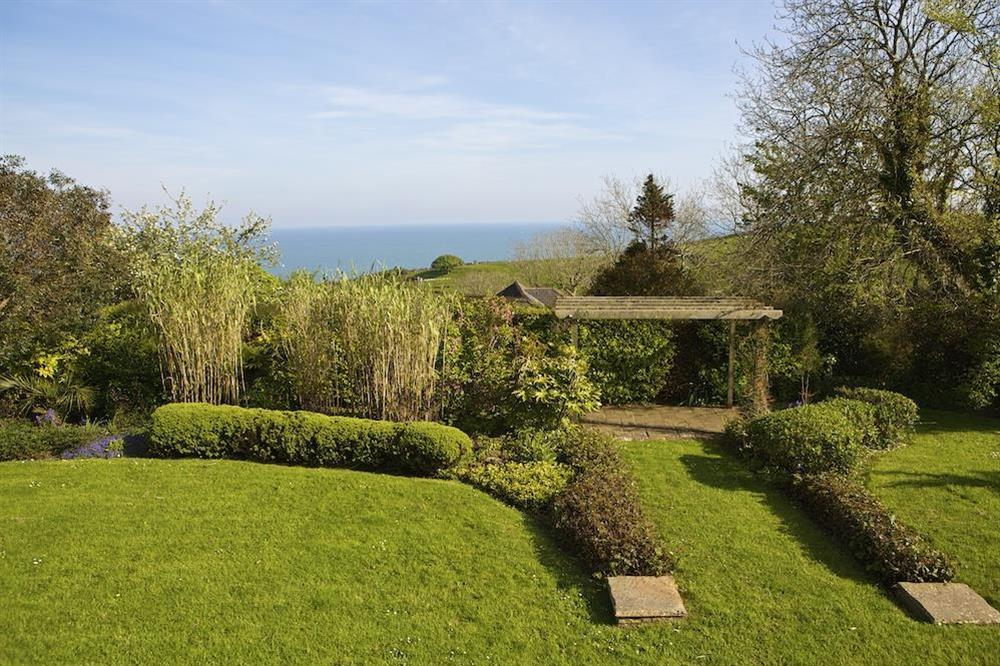 Extensive mature gardens with views towards Start Bay at Seaway House in , Strete