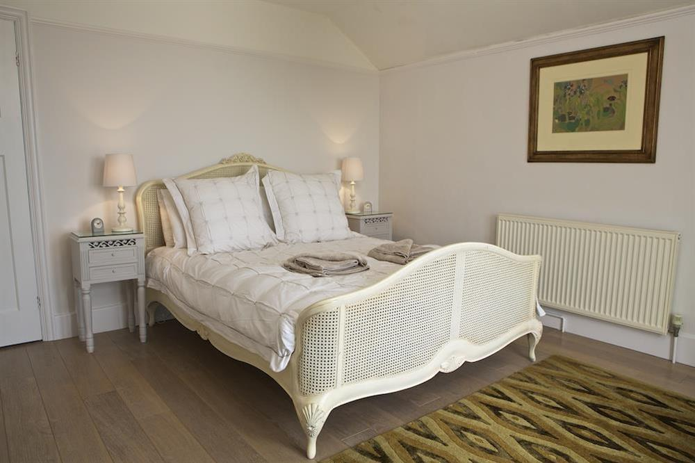 Master bedroom with King size bed at Seaway House in , Strete