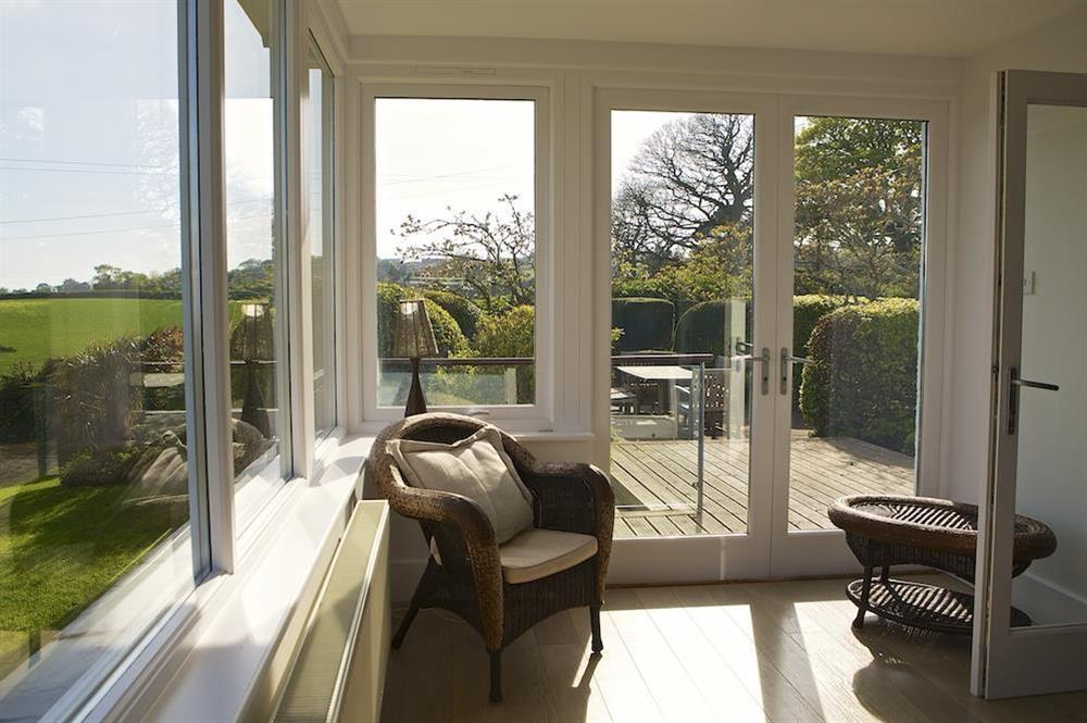 Sun room leading to the garden at Seaway House in , Strete