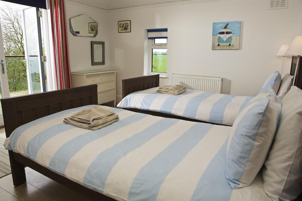 Twin bedroom with access to the balcony at Seaway House in , Strete