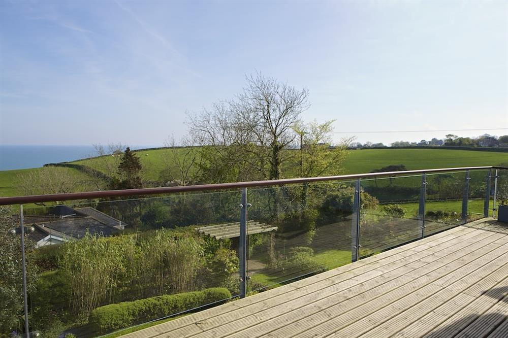 Views from the balcony over the gardens towards Start Bay at Seaway House in , Strete