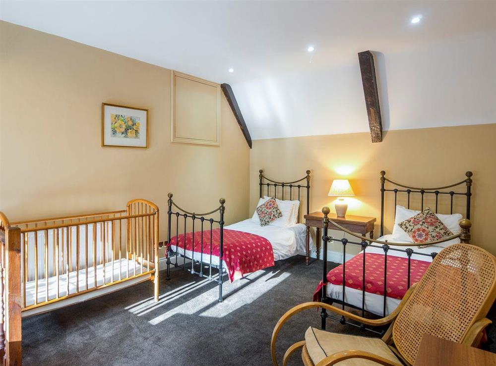Airy twin bedroom with cot at The Sedgeford Hall,