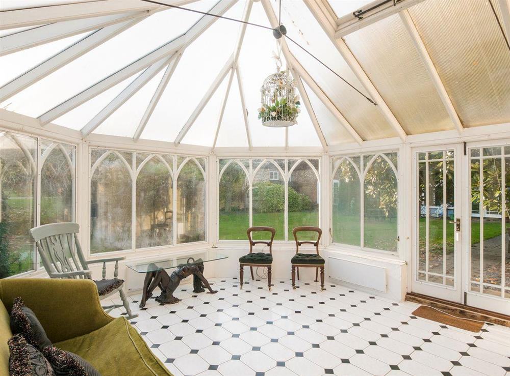 Bright and sunny conservatory at The Sedgeford Hall,