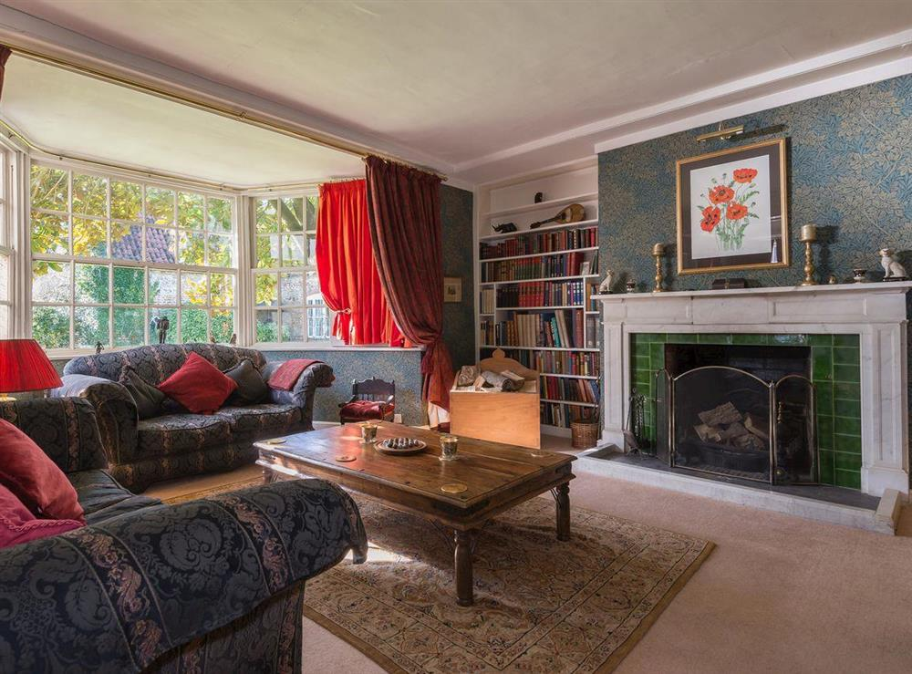 Comfortable living room with real log fire at The Sedgeford Hall,