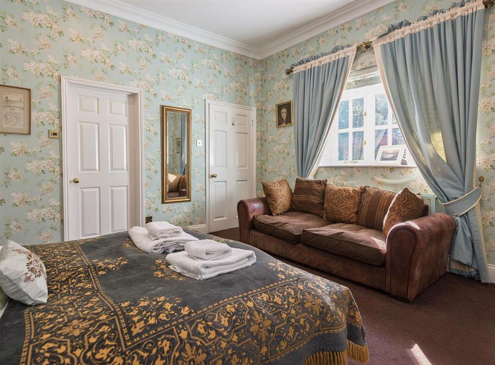 Double bedroom with sofa at The Sedgeford Hall,