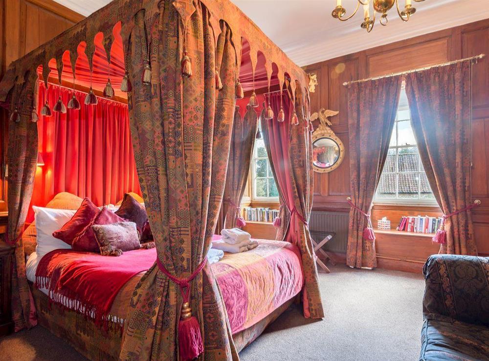 Impressive mahogany four poster bedroom at The Sedgeford Hall,