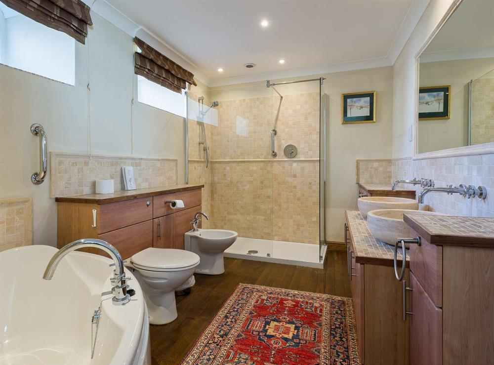 Large bathroom with shower at The Sedgeford Hall,