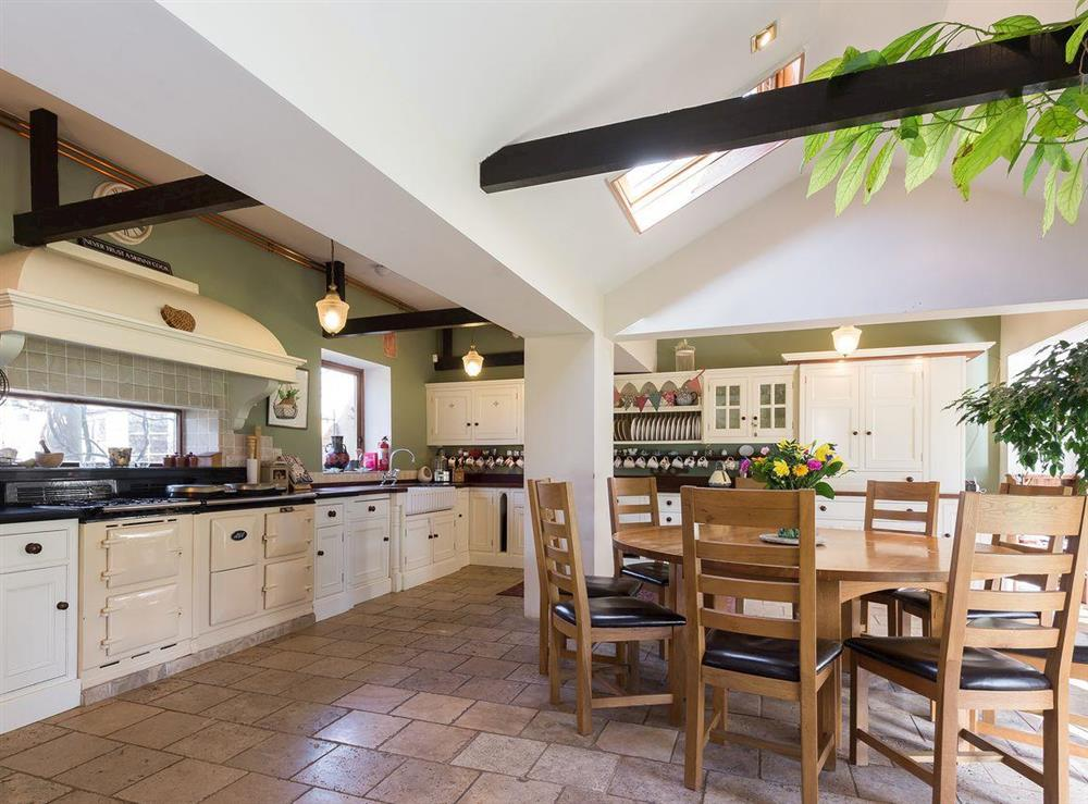 Large kitchen & dining area with Aga range at The Sedgeford Hall,