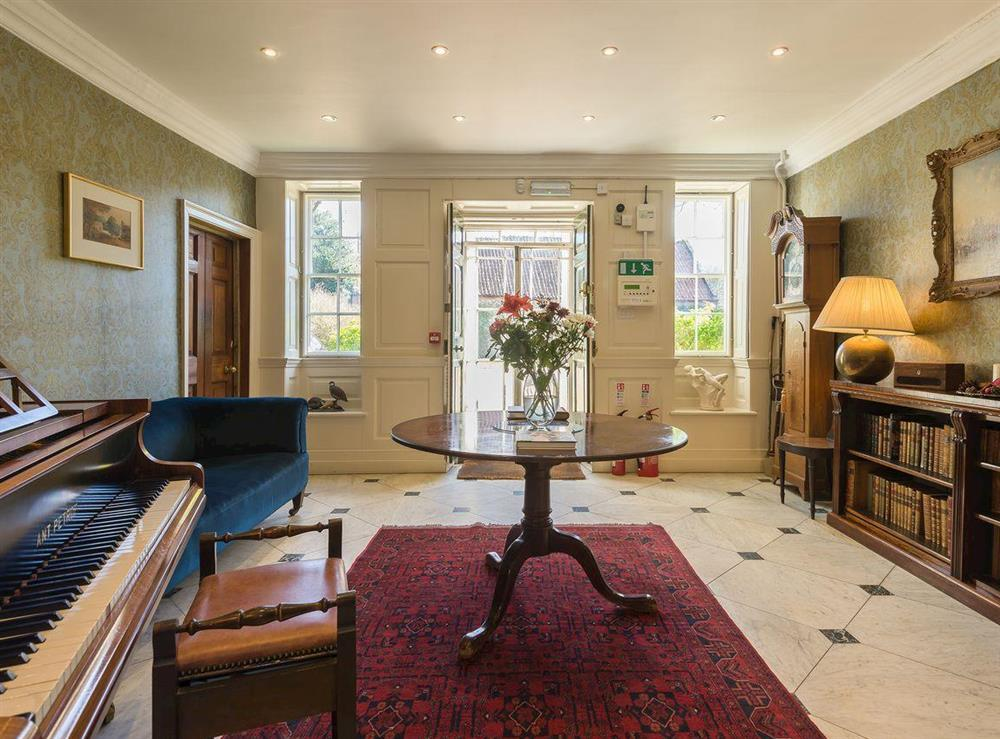 Music room with piano at The Sedgeford Hall,