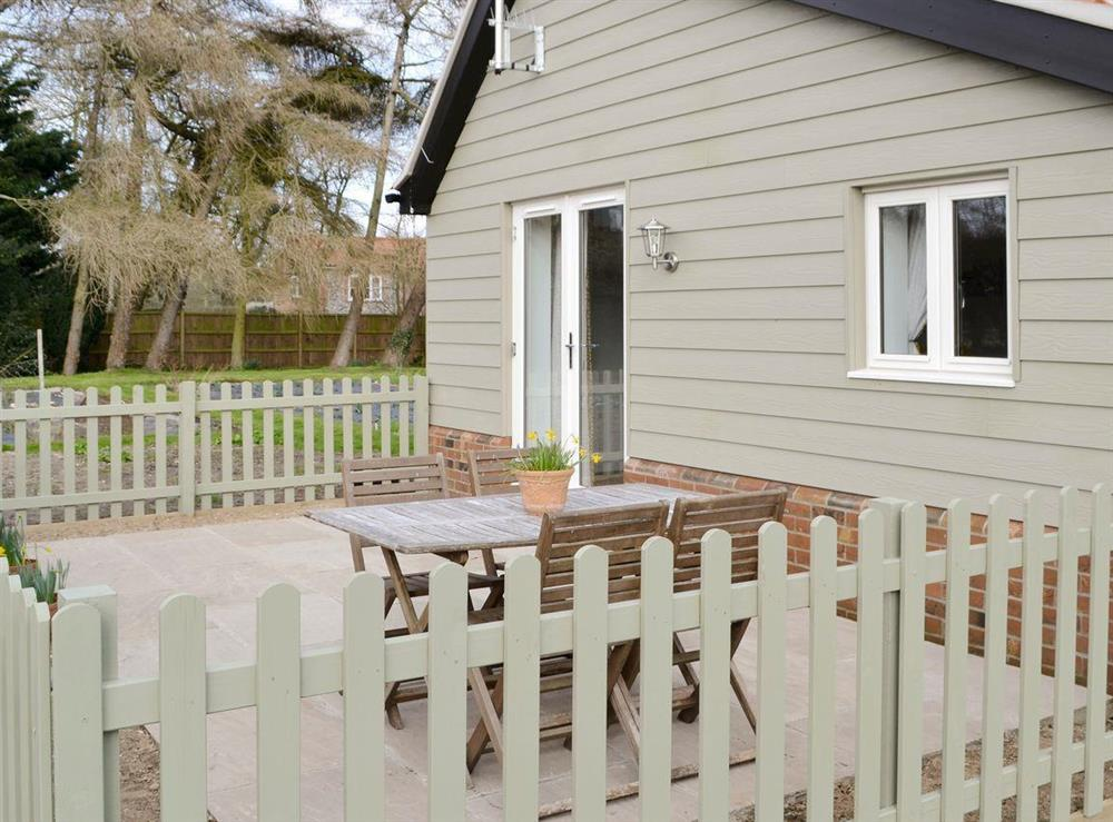 Enclosed patio with outdoor furniture at The Boat House,