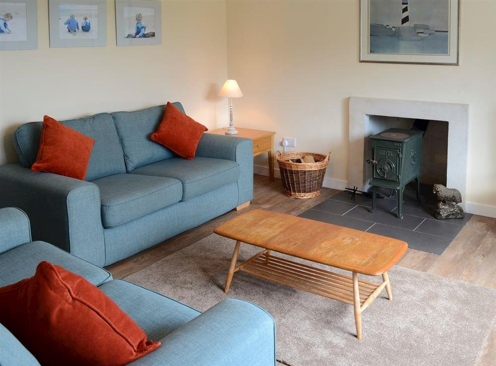 """Comfortable lounge with wood burner and 32"""" Freeview TV at Shepherds Cottage in Culrain, Ardgay, near Tain, Highlands, Ross-Shire"""