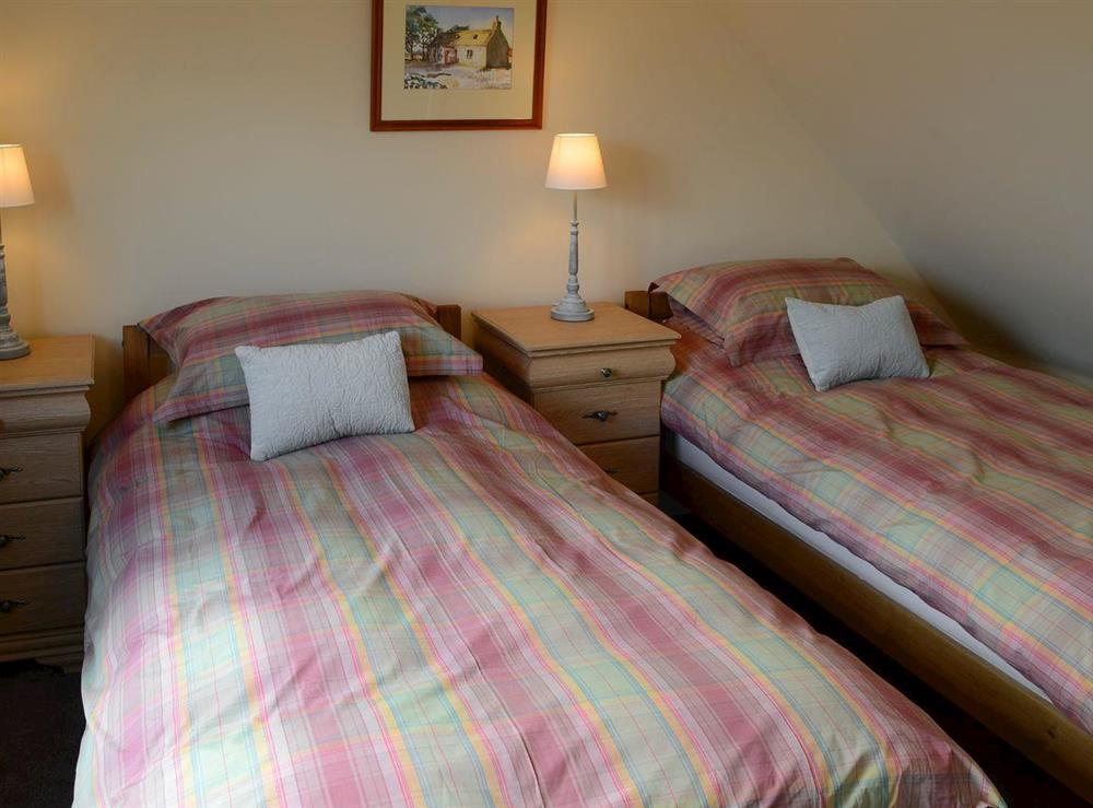 Cosy bedroom with twin beds at Shepherds Cottage in Culrain, Ardgay, near Tain, Highlands, Ross-Shire