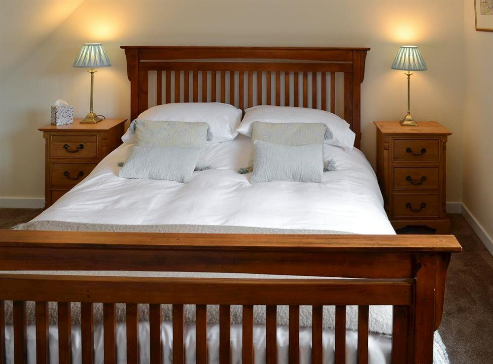 Relaxing bedroom with king-size bed at Shepherds Cottage in Culrain, Ardgay, near Tain, Highlands, Ross-Shire