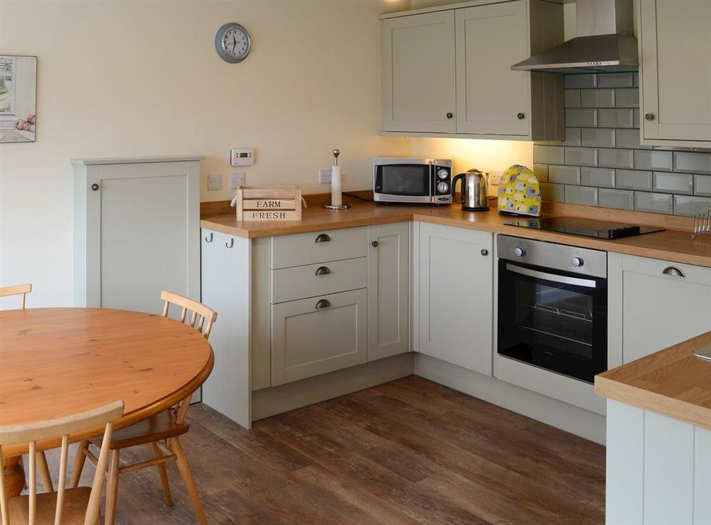 Well-equipped kitchen and dining area at Shepherds Cottage in Culrain, Ardgay, near Tain, Highlands, Ross-Shire
