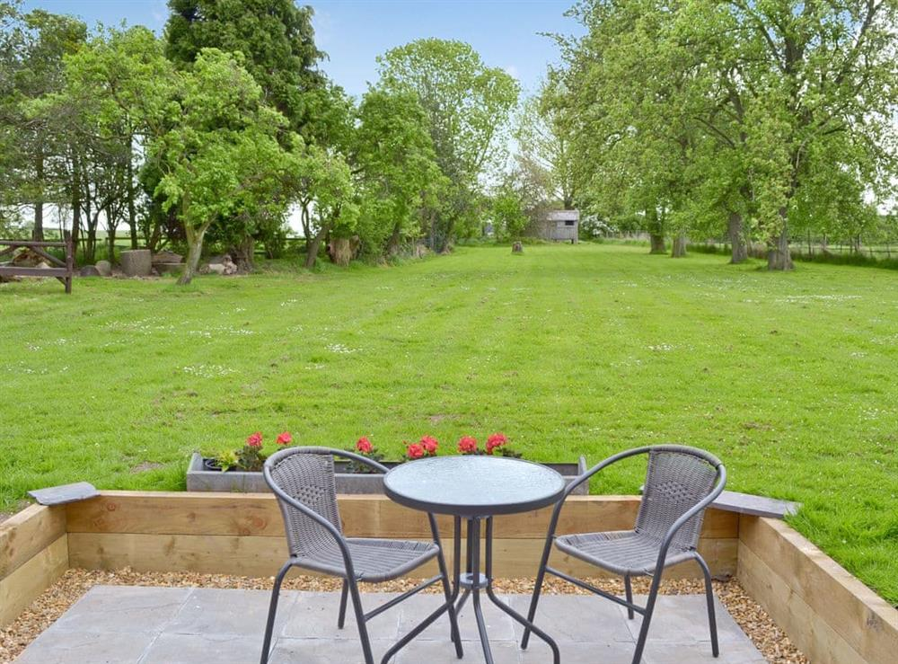 Patio area with large private garden at Shires Loft in Whitchurch, Shropshire