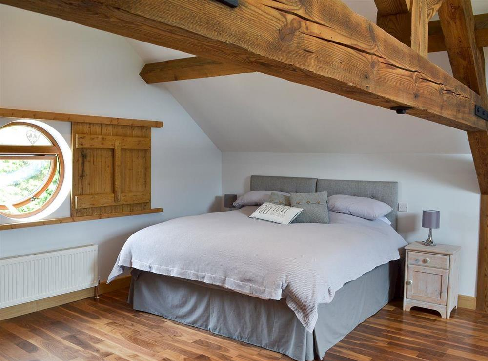 Spacious double bedroom with roll top bath at Shires Loft in Whitchurch, Shropshire