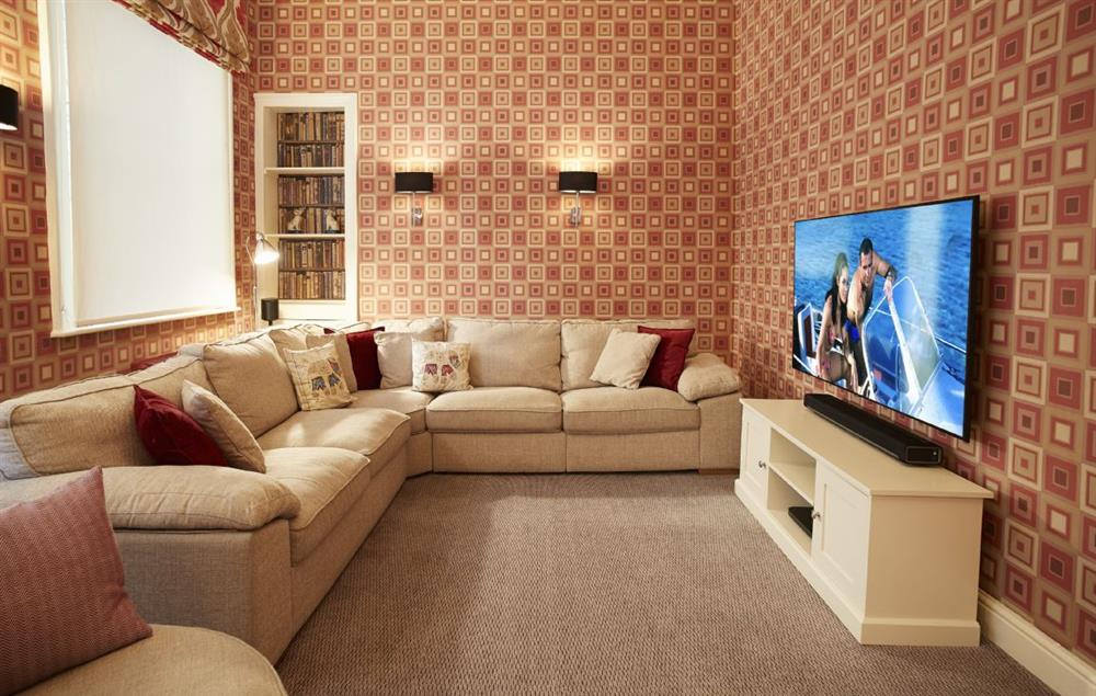 Ground floor: Television room with 50' television with sensor control and surround sound