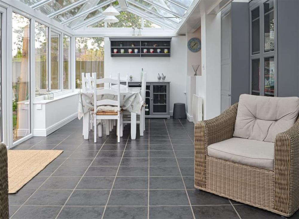 Conservatory with dining area at Sleepy Willow in Little Snoring, near Fakenham, Norfolk