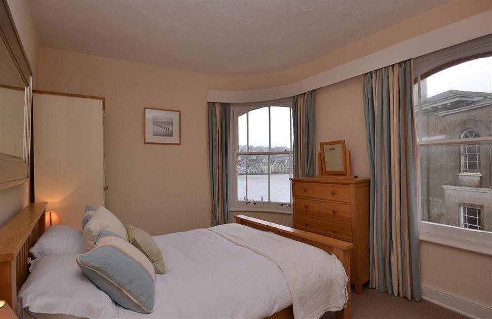 The master bedroom boasts 3 picture windows at Slipway House, Dartmouth
