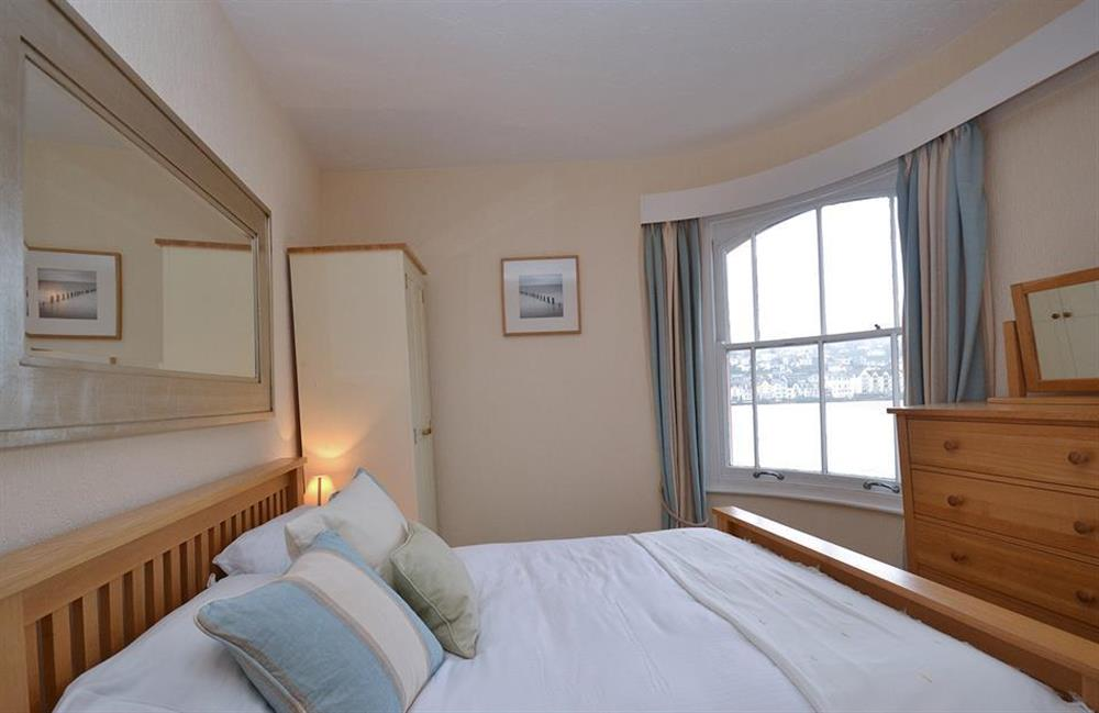 The master bedroom with River Dart views at Slipway House, Dartmouth