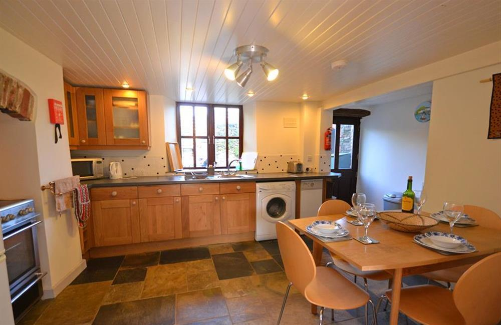 Another view of the kitchen with a door to the rear garden at Solstice, Blackawton