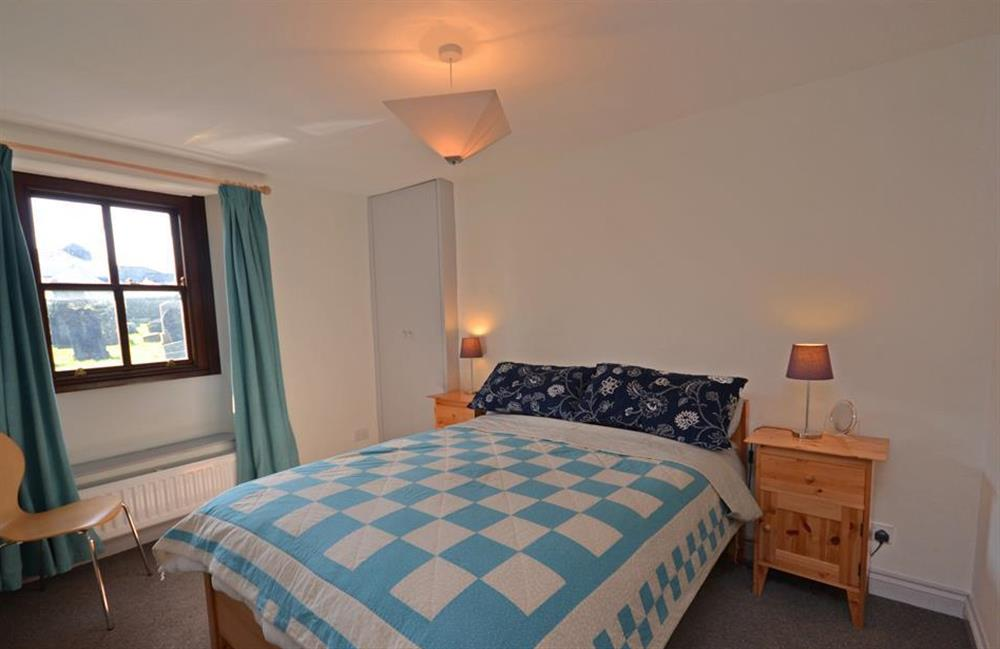 The double bedroom enjoys views towards the village's church at Solstice, Blackawton