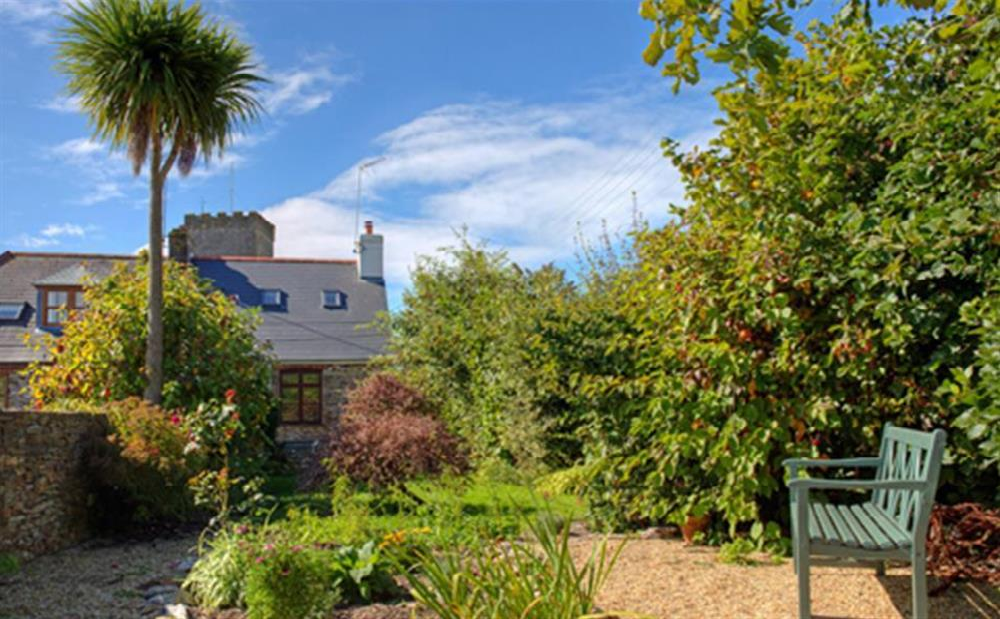 The sunny rear enclosed garden at Solstice, Blackawton