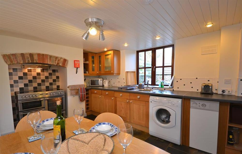 The traditional but modern kitchen diner is equipped with a range oven, washing machine, fridge freezer and microwave.