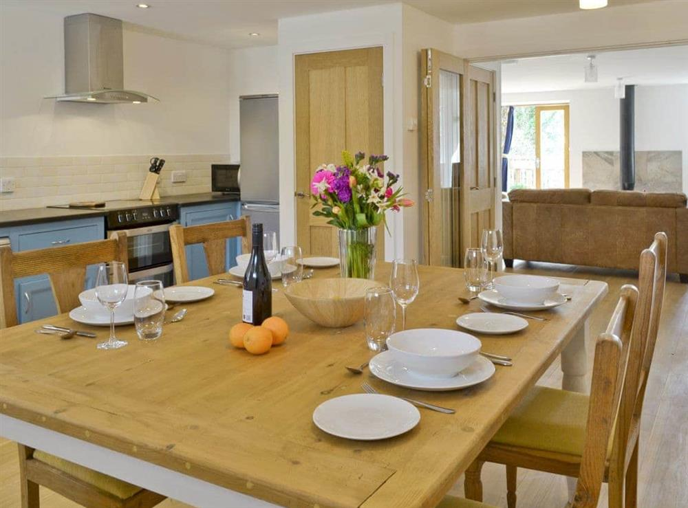 Dining area within kitchen with open aspect to lounge area at Southlake Barn in Dousland, near Yelverton, Devon