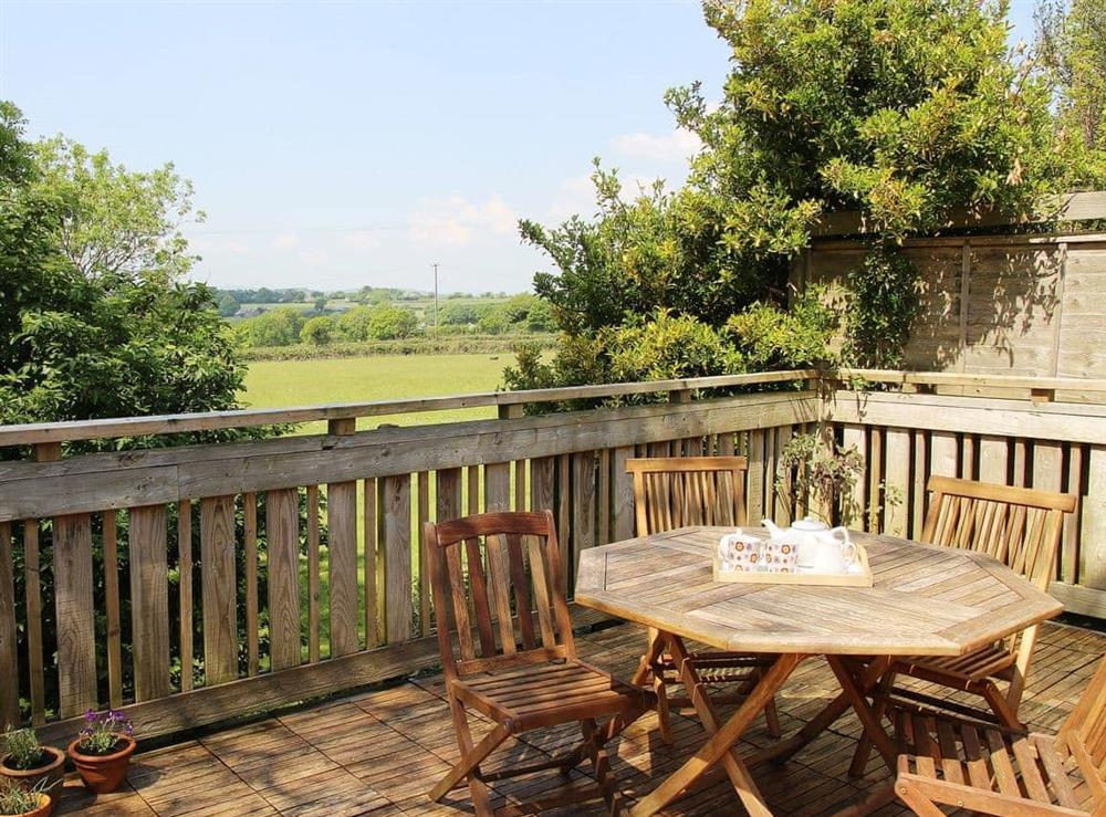 Spacious balcony accessed from lounge with panoramic rural views at Southlake Barn in Dousland, near Yelverton, Devon