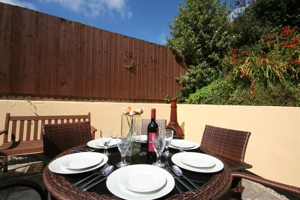 Good sized private terrace to the rear of the property with table, benches and barbecue (photo 2) at Southview in Blackawton, Nr Dartmouth