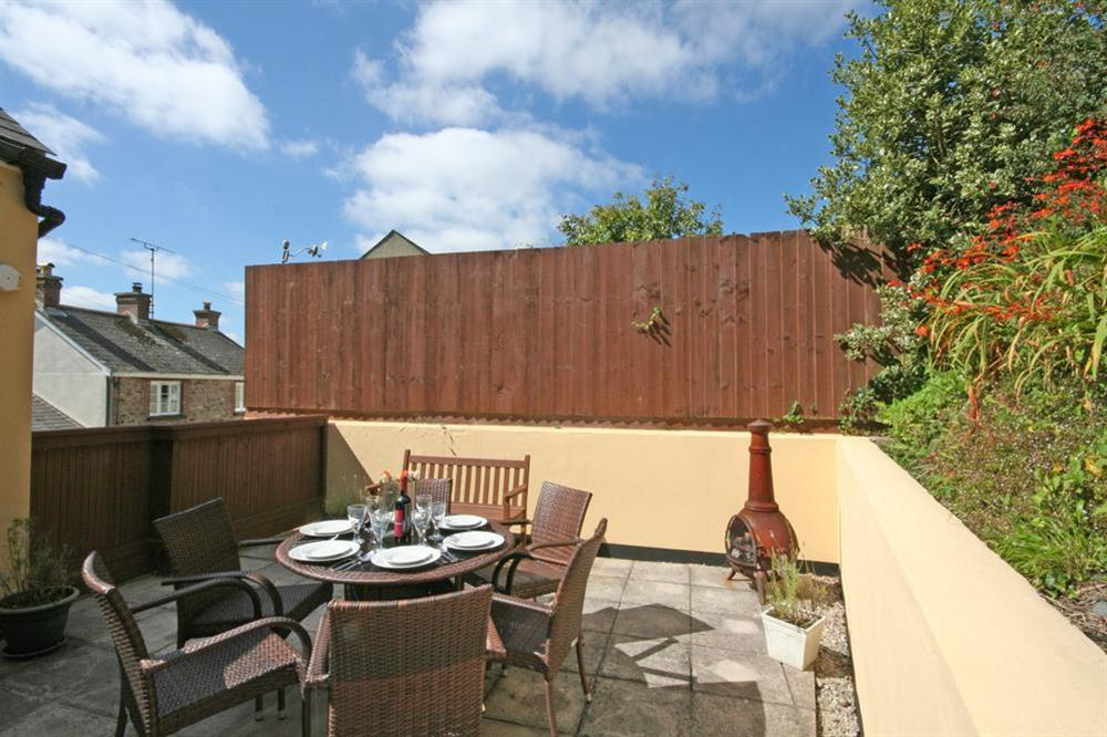 Good sized private terrace to the rear of the property with table, benches and barbecue at Southview in Blackawton, Nr Dartmouth