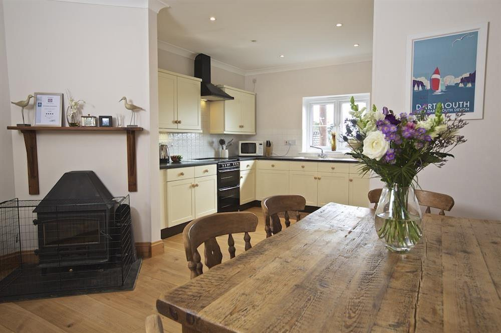 Lounge/dining room with wood-burning stove (photo 4) at Southview in Blackawton, Nr Dartmouth